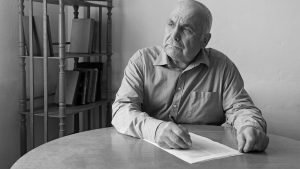 Old Man Signing Lasting Power Of Attorney