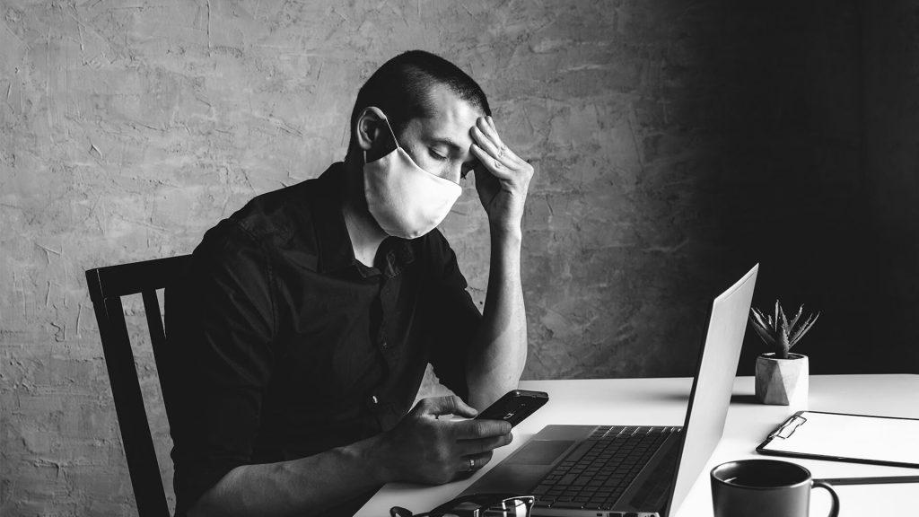Furlough fraud man working on laptop