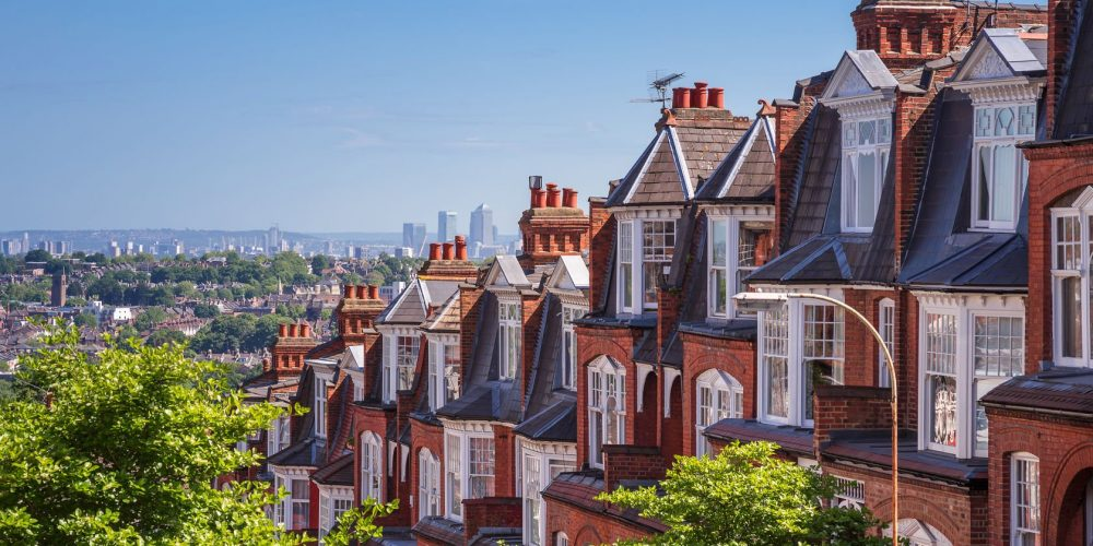 48202407 - brick houses of muswell hill and panorama of london with canary wharf, london, uk
